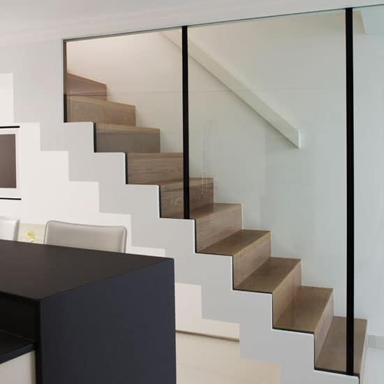 walnut and glass floating staircase